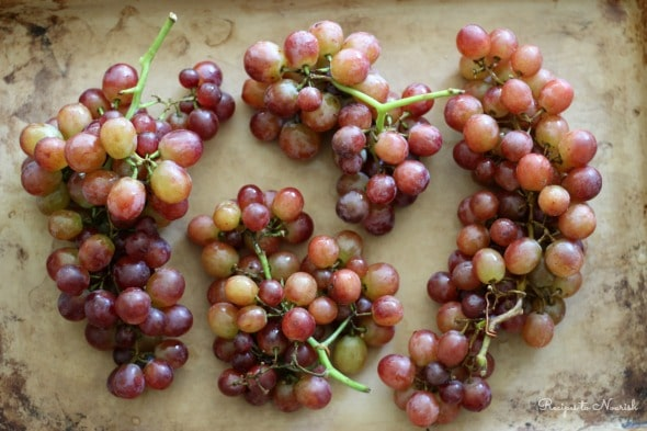 Roasted Grapes are sweet little juicy gourmet bites of bliss. With a touch of sea salt and some buttery goodness, these roasted grapes are sure to be a hit. | Recipes to Nourish