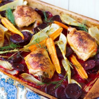(Ad) This One Pan Roasted Chicken with Citrus Beets is an elegant, yet humble and cozy meal. The whole dinner bakes on one sheet pan in just one hour! Savory chicken is roasted to perfection with crispy skin and surrounded by delicious citrusy and herby sweet beets, carrots and fennel. | Recipes to Nourish