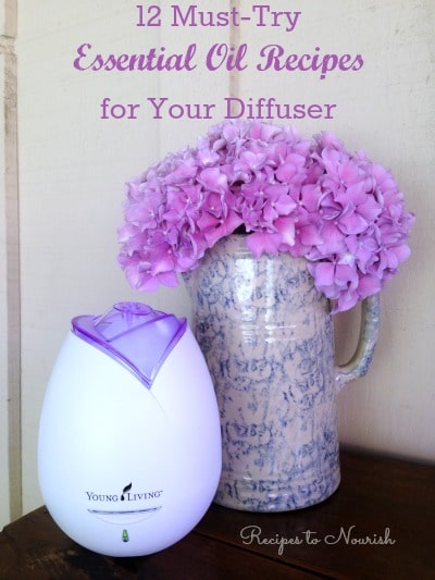 Essential oil diffuser with fresh hydrangeas in a pitcher.