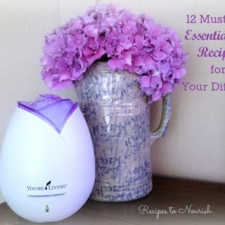 Essential oils diffuser and fresh hydrangeas in a pitcher.
