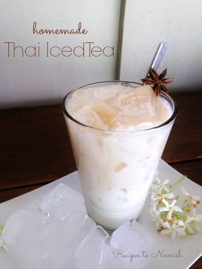 Thai iced tea served over ice with star anise.