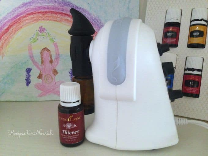 Essential oils diffuser, essential oils and art with a rainbow.