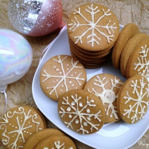 Gingerbread cookies frosted as snowflakes.
