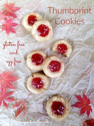 Gluten Free Thumbprint Cookies ... soft, buttery almond flavored shortbread-ish cookies filled with all-fruit strawberry jam. Perfect for any holiday! | Recipes to Nourish