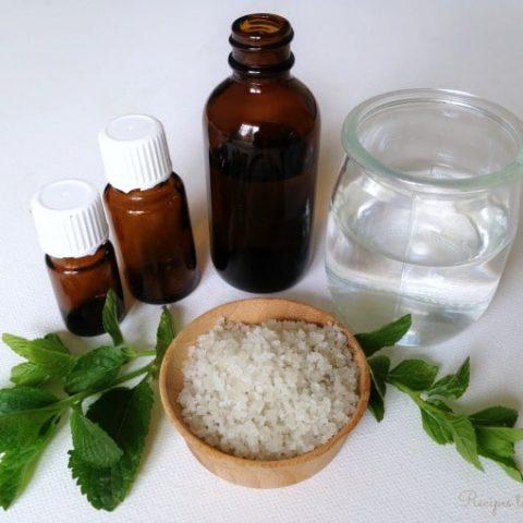 Essential oil bottles, water, sea salt and fresh herbs.