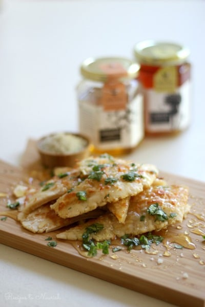 Grain Free Garlic Honey Flatbread is a delicious appetizer or side for any meal. This easy, no yeast recipe is infused with savory garlic and sweet honey. Serve it with generous drizzles of raw honey, chopped fresh herbs, coarse sea salt and a little bit of quality organic extra virgin olive oil. | Recipes to Nourish