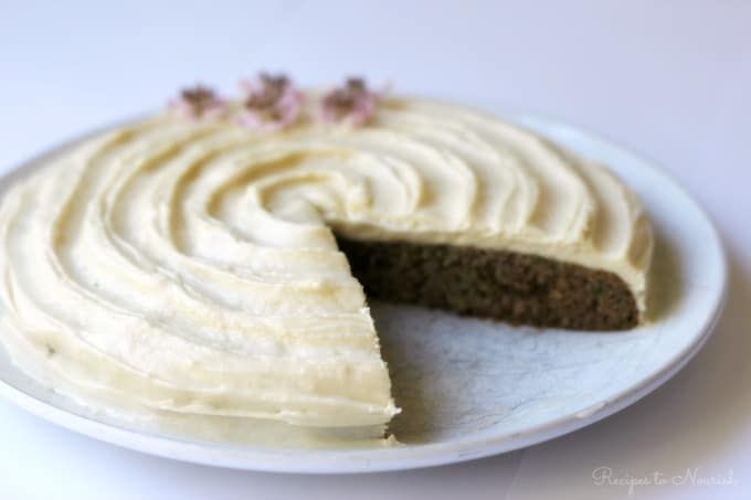 Zucchini Cake with thick, delectable cream cheese frosting is the perfect summertime treat! This delicious, moist, grain free cake is packed full of whole, real food ingredients, so go ahead and eat the cake! | Recipes to Nourish