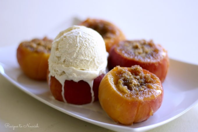 Stuffed peaches with a scoop of vanilla ice cream.