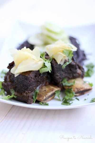 Instant Pot Asian Short Ribs seem so elegant, but they're super easy to make. Served with cucumber sunomono and cold noodles, these flavorful, tender, fall apart grass-fed short ribs are sure to please. | Recipes to Nourish