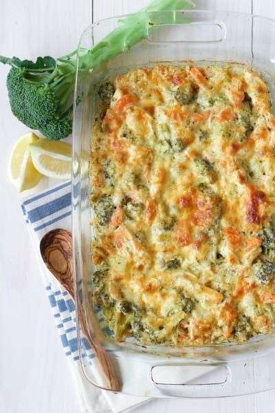 Cheesy chicken broccoli casserole with fresh broccoli and lemon.