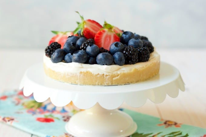 Cheesecake tart topped with fresh berries.