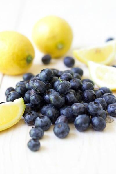 Fresh blueberries, fresh lemons and lemon slices.