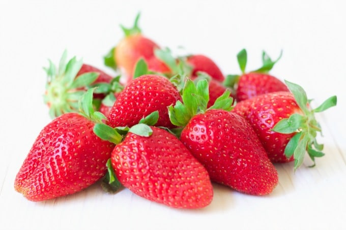 Several fresh strawberries.