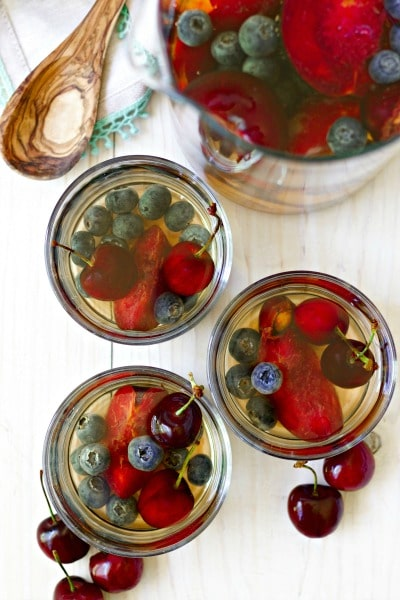 Summer heat has everyone craving refreshing, delicious drinks. This non alcoholic Herbal Summer Sangria is a fun twist on the original. The best part is everyone can enjoy this, even kids! It's perfect served at summer parties, BBQ's, potlucks, holiday celebrations or simply just to have in the fridge as a hydrating drink throughout the week. | Recipes to Nourish