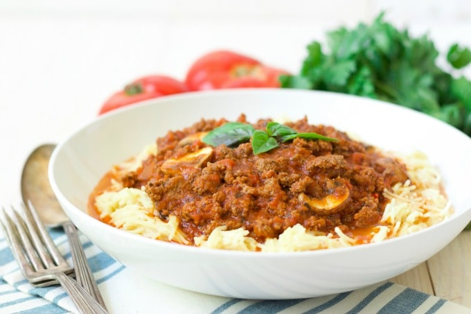 Bowl of spaghetti with bolognese sauce, fresh tomatoes and herbs.