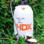 Bottle of homemade vinegar weed killer spray.