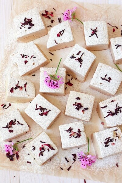 These Vitamin C Hibiscus Rose Hip Marshmallows are naturally sweetened and Paleo friendly. There's nothing more irresistible than homemade, real food marshmallows. Super fluffy and sweet with a delicate herbal flavor, these easy-to-make, light pink marshmallows are also packed with a vitamin C boost. | Recipes to Nourish