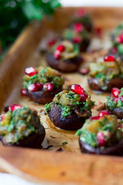 (ad) Paleo Tea Infused Bacon Herb Stuffed Mushrooms are the most delicious, deeply flavored little bites of goodness. Overflowing with herby aromatics, these baby mushrooms are stuffed with caramelized onions, crispy bacon and filled with crunchy, juicy pomegranate arils. They're so easy to make, Whole30 friendly and perfect to serve at parties. | Recipes to Nourish