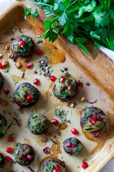 Stuffed mushrooms with herbs and pomegranate arils.