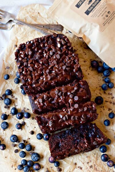 Chocolate banana bread with blueberries and a bag of tea.