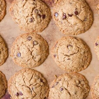 Chocolate chip cookies on a stoneware baking sheet.