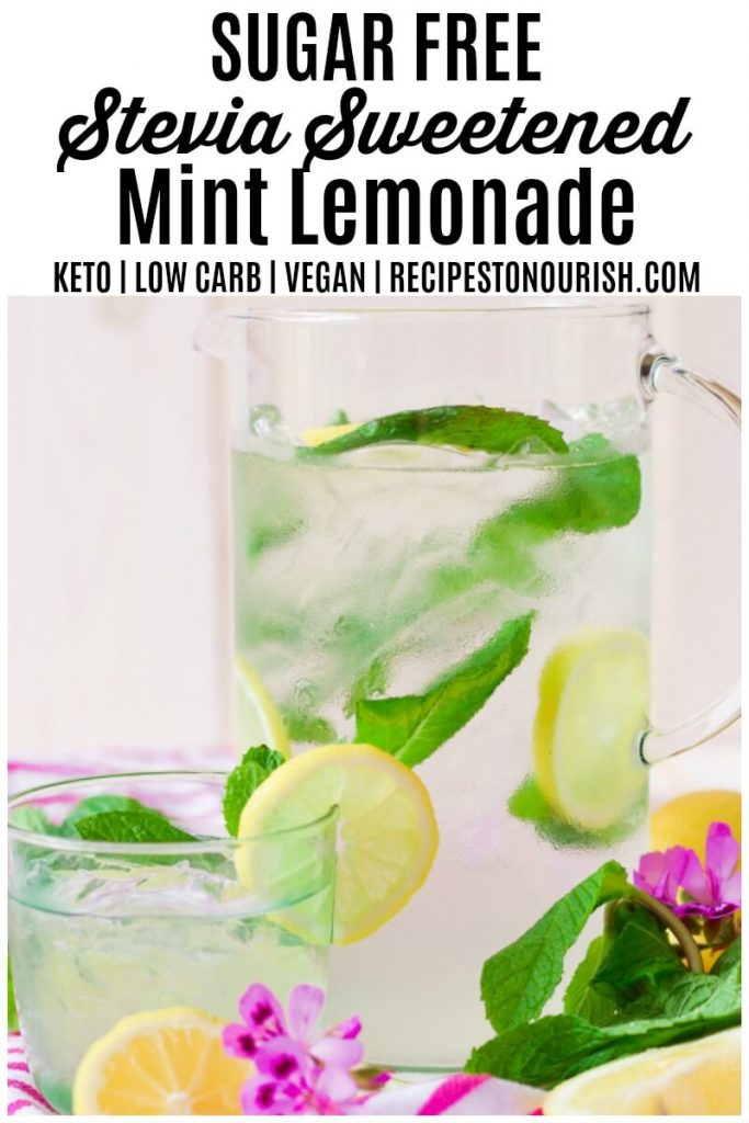 Mint lemonade in a pitcher with fresh mint and lemon slices.