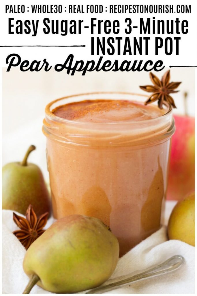 Jar of homemade pear applesauce next to fresh pears, apples and star anise pods.