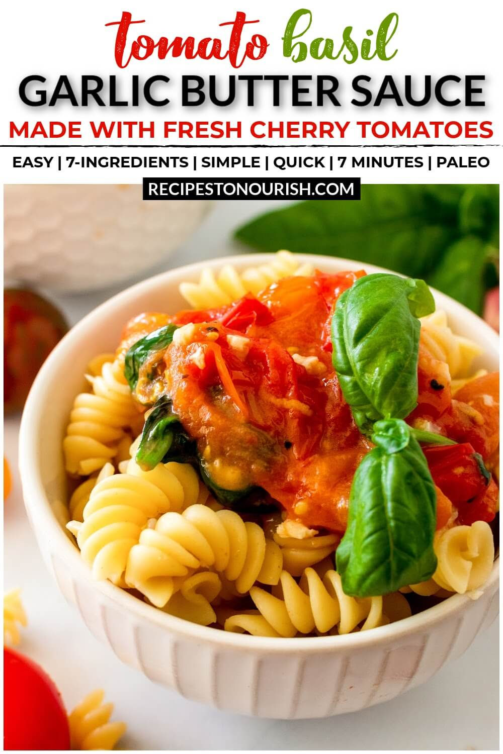 Bowl full of pasta topped with homemade tomato basil sauce with a sprig of fresh basil.