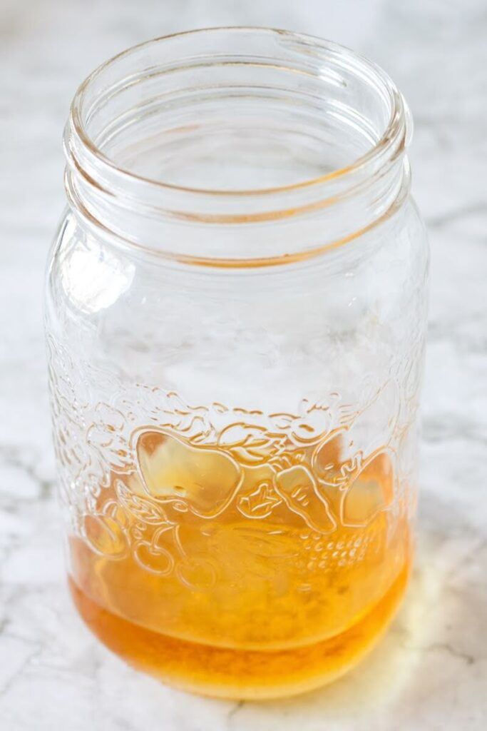 Mason jar filled 1/4 full with apple cider vinegar.