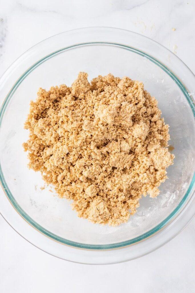 A mixing bowl full of a crisp mixture filling.
